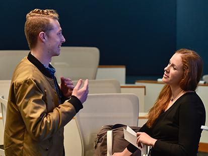 Drew Pilewski, who's studying radio-TV sports journalism at the Missouri School of Journalism, speaks with Melissa Gersin after the seminar. Photo: Nate Brown/RJI