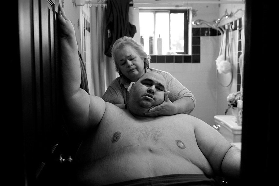 This first image of Hector Garcia Jr. and his mother giving him an improvised bath is so loving. Lisa's story about Garcia and his battle with obesity made this common struggle more human and nuanced. We see how hard he works, how much he is loved, how difficult the journey is. We fall in love with him, we root for him. We gain more empathy for his condition which is shared by many people in our community. Photo by Lisa Krantz