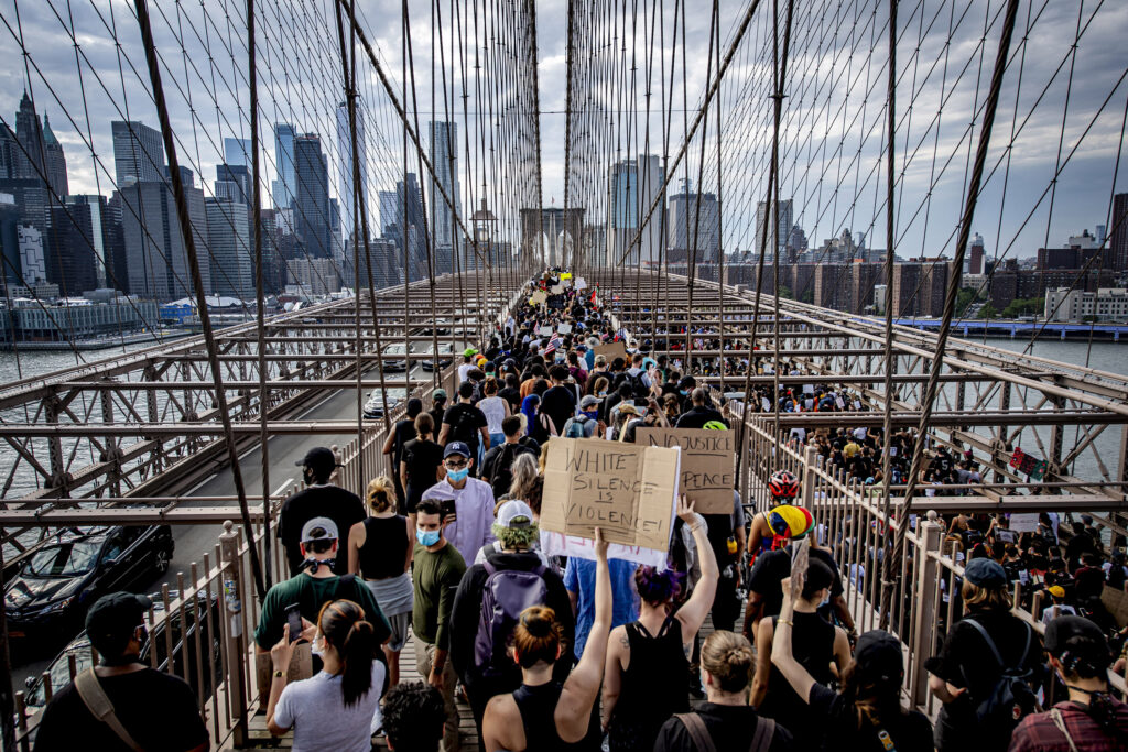 In the wake of the death of George Floyd at the hands of Police in Minneapolis, Anger and frustration boiled over into loud cries for justice. Protests against police brutality erupted both in big cities and small towns across the country. In New York City and its suburbs, Protestors, and allies of the Black Lives matter movement took to the streets. - Protestors march on the Brooklyn Bridge towards Manhattan after a memorial service for George Floyd, whose death in police custody, in Minneapolis, sparked nationwide protests and riots. Thursday June 4, 2020