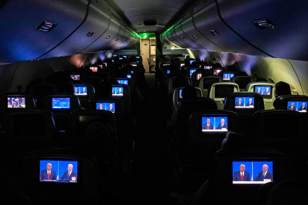 FLIGHT OVER THE U.S. - OCTOBER 22: The final presidential debate between President Donald Trump and Democratic nominee Joe Biden appears on screens during a flight from Detroit on Thursday, Oct. 22, 2020. (Salwan Georges / The Washington Post)