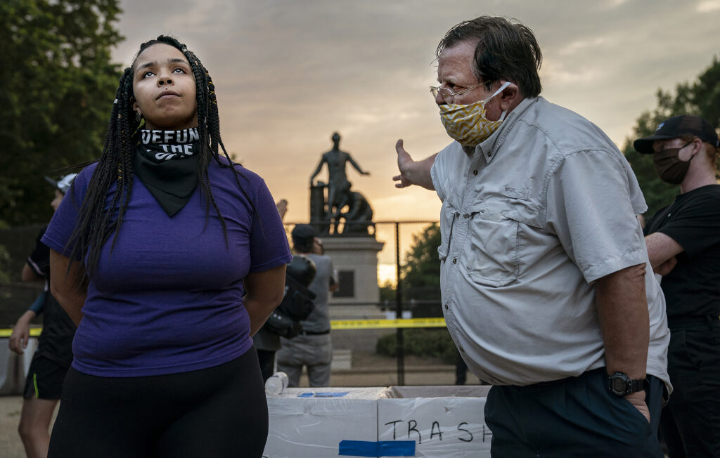 Anais, 26, who wants to remove the Emancipation statue in Lincoln Park in Washington, DC, argues with a man who argues to keep it, June 25th, 2020. Critics say the Emancipation Memorial — which shows Lincoln holding a copy of the Emancipation Proclamation as an African American man in a loincloth kneels at his feet — is demeaning in its depiction of African Americans. The drive to remove the statue comes amid a wave of calls to take down monuments of Confederate generals.