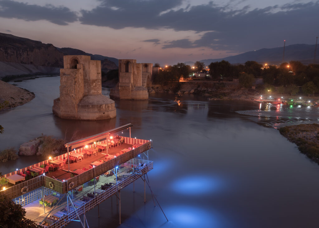 A view of ancient Hasankeyf is about to be flooded with its history which goes back approximately 12,000 years ago. With the completion of the Ilõsu Dam, the evidence of many existed civilizations along with their historical ruins will be vanished. The photo was taken on Sep. 15, 2019 My project tells the story about people from the Hasankeyf where is one of the oldest inhabited places in the world, who had to leave their ancient villages left underwater. Hasankeyf is located in the area of Mesopotamia that is also known as the Cradle of Civilizations, where both eastern and western civilizations have lived for over 12,000 years. The Ilõsu Dam and the hydroelectric power plant (HPP) project construction began in 2006 and was completed in 2019. In June 2019 the floodgates were closed in order to keep water inside. The Ilõsu dam project, along with other dams built in this region, is a reflection of the state's water policies. For this reason, as an open-air museum with many layers of time, Hasankeyf meets most of the required criteria to merit UNESCO's World Heritage status, yet it has not been submitted nomination proposals by the state. The Tigris Valley is in the ancient silk road, an area of approximately 100 km was buried underwater. 12,000 years of HasankeyfÕs history, hundreds of endemic species, and approximately 300 archaeological sites were affected by the dam's water retention, furthermore, around 100,000 people were forced to migrate. Regarding the Ilõsu Project, a total of 199 villages of Batman, Siirt, Diyarbakir, Mardin, Sirnak, and Hasankeyf, were completely submerged. Most of the population of these villages are of Kurdish and Arab origin. These people had to gain new experiences that they have never had before to overcome these extraordinary circumstances. For instance, a woman carried her husband's grave while another eighty-year-old woman got on the boat for the first time in her life, both had to make an effort to adapt to the fact that the whole
