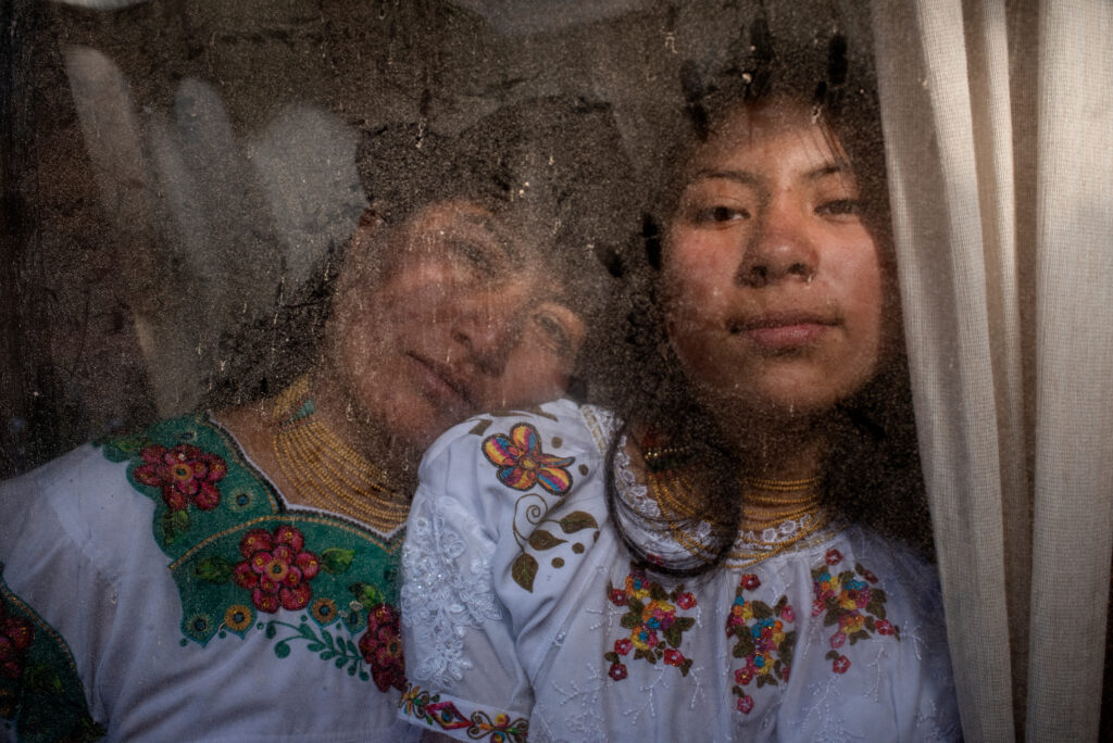 María Isolina Pupiales, 38 years old, and her daughter Sharik Nayeli Guatemal, 15 years old, singers from the Karanki indigenous community, pose for a portrait at their house on the afternoon of October 10, 2020. San Clemente, Ibarra-Ecuador.